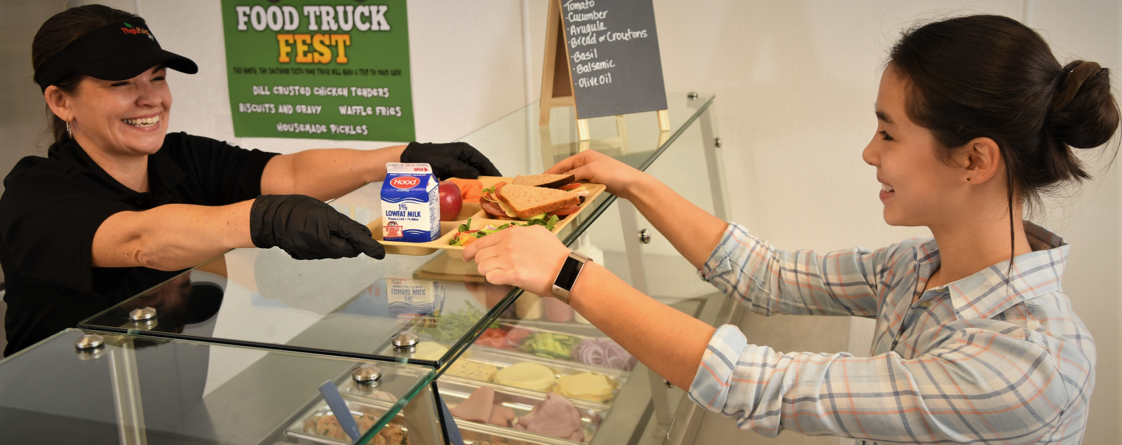 Student being served a deli lunch